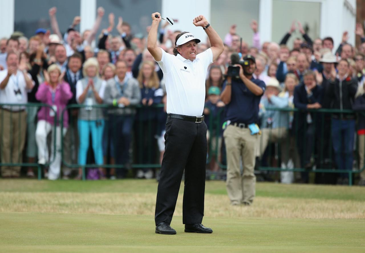 GULLANE, SCOTLAND - JULY 21: Phil Mickelson of the United States reacts to a birdie putt on the 18th hole during the final round of the 142nd Open Championship at Muirfield on July 21, 2013 in Gullane, Scotland. (Photo by Andy Lyons/Getty Images)
