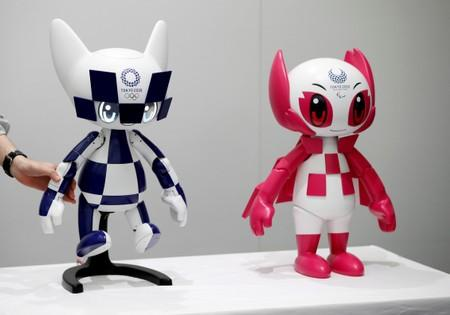 An employee of Toyota Motor Corp. displays Tokyo 2020 mascot robots Miraitowa and Someity which will be used to support the Tokyo 2020 Olympic and Paralympic Games, during a press preview in Tokyo