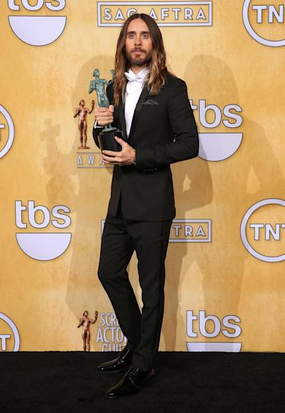 """Jared Leto poses in the press room with the award for outstanding performance by a male actor in a supporting role for """"Dallas Buyers Club"""" at the 20th annual Screen Actors Guild Awards at the Shrine Auditorium on Saturday, Jan. 18, 2014, in Los Angeles. (Photo by Matt Sayles/Invision/AP)"""