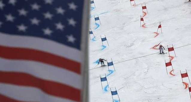 Alpine Skiing - Pyeongchang 2018 Winter Olympics - Team Event - Yongpyong Alpine Centre - Pyeongchang, South Korea - February 24, 2018 - Patricia Mangan of the U.S. (R) and Charlie Guest of Britain compete. REUTERS/Stefano Rellandini