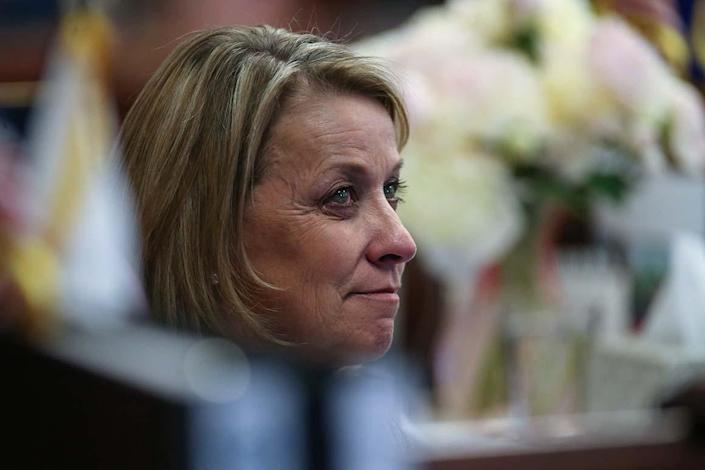 Nevada Sen. Barbara Cegavske, R-Las Vegas, listens to colleagues pay tribute to her 18-years of public service during a Senate floor session on the final day of the 77th Legislative session at the Legislative Building in Carson City, Nev., on Monday, June 3, 2013. (AP Photo/Cathleen Allison)