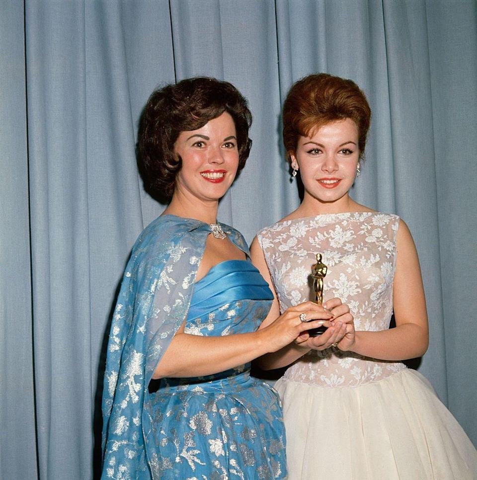"""<p>Shirley attended the 1961 Academy Awards to present the Academy Juvenile Award, which she was the first recipient of, to Hayley Mills. Since Hayley could not attend the show, her <a href=""""https://www.oscars.org/oscars/ceremonies/1961/U?qt-honorees=1"""" rel=""""nofollow noopener"""" target=""""_blank"""" data-ylk=""""slk:award was presented to Annette Funicello"""" class=""""link rapid-noclick-resp"""">award was presented to Annette Funicello</a> (right). </p>"""