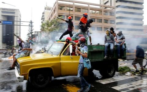 Demonstrators ride on a truck while rallying against Venezuela's President Nicolas Maduro's government in Caracas, Venezuela, June 29, 2017. - Credit: Reuters