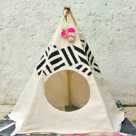 """<p>Give your pet a unique super cosy place they can call home with this printed black stripe tipi. Handcrafted in London from 100% hand printed cotton and locally sourced wood. <br></p><p>£49 <a href=""""https://www.etsy.com/uk/listing/186181532/black-stripe-cat-dog-tipi?ga_order=most_relevant&ga_search_type=all&ga_view_type=gallery&ga_search_query=pet&ref=sr_gallery_35"""" rel=""""nofollow noopener"""" target=""""_blank"""" data-ylk=""""slk:Puptart Handmade"""" class=""""link rapid-noclick-resp"""">Puptart Handmade</a></p>"""