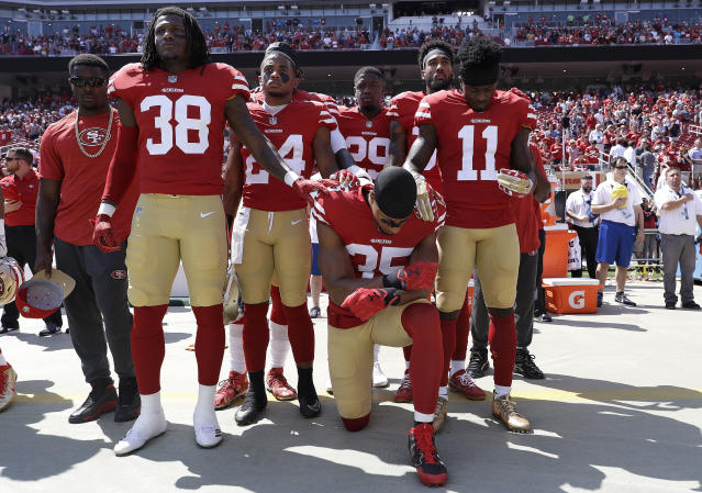 <p>San Francisco 49ers safety Eric Reid (35) kneels in front of teammates during the playing of the national anthem before an NFL football game between the 49ers and the Carolina Panthers in Santa Clara, Calif., Sunday, Sept. 10, 2017. (AP Photo/Marcio Jose Sanchez) </p>