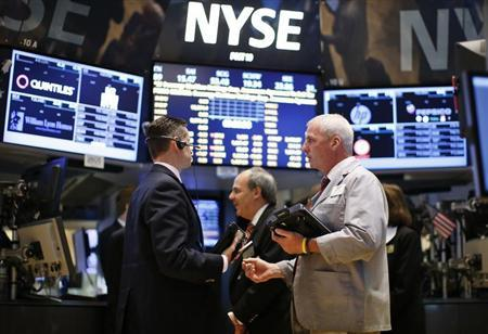 Traders work on the main trading floor of the New York Stock Exchange shortly after the opening bell in New York
