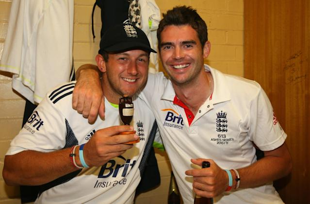England cricketers Tim Bresnan (L) and James Anderson celebrate in the dressing room with a replica of the Ashes urn, after winning the series 3-1 during day five of the Fifth Ashes Test match between Australia and England, at Sydney Cricket Ground, in Sydney, Australia, on January 7, 2011. AFP PHOTO/TOM SHAW/POOL IMAGE STRICTLY RESTRICTED TO EDITORIAL USE - STRICTLY NO COMMERCIAL USE (Photo credit should read TOM SHAW/AFP/Getty Images)