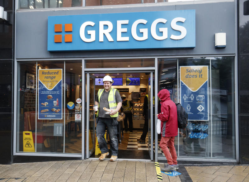 RETRANSMISSION - correcting byline to Danny Lawson, and amending headline. A man leaves a branch of Greggs in Leeds as the bakery chain reopens 800 stores across the UK following the easing of coronavirus lockdown restrictions.