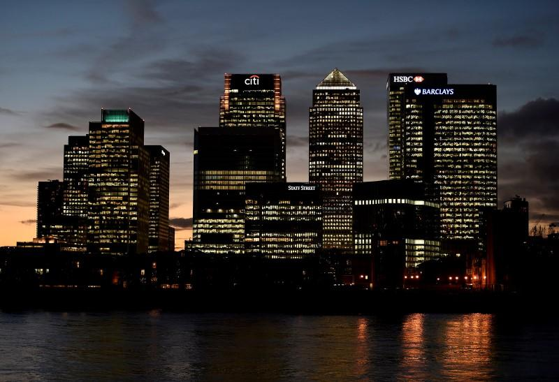 The Canary Wharf financial district is seen at dusk in east London