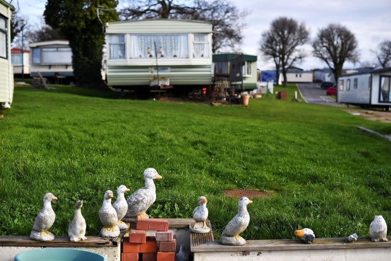 Garden ornaments are seen close to caravans at Elmhurst Caravan Park in Eastchurch
