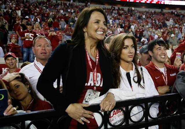 TUSCALOOSA, AL - OCTOBER 19: (L-R) Tony McCarron, Dee Dee Bonner and his girlfriend Katherine Webb await AJ McCarron #10 of the Alabama Crimson Tide after their 52-0 win over the Arkansas Razorbacks at Bryant-Denny Stadium on October 19, 2013 in Tuscaloosa, Alabama. (Photo by Kevin C. Cox/Getty Images)