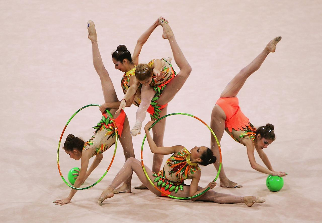 ATHENS - AUGUST 26:  Brazil dances in the rhythmic gymnastics group qualifications on August 26, 2004 during the Athens 2004 Summer Olympic Games at the Galatsi Olympic Hall in Athens, Greece. (Photo by Mike Hewitt/Getty Images)