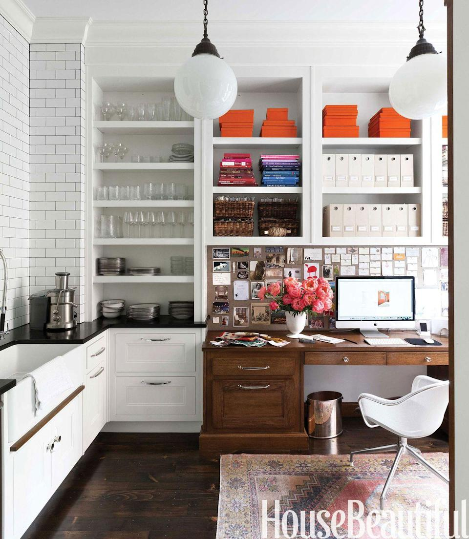 """<p>If you can stay organized, this organizational system is for you. Seeing everything means you'll never lose a file or supply. In this <a href=""""https://www.housebeautiful.com/room-decorating/kitchens/news/a1923/top-pin-of-the-day-030614/"""" rel=""""nofollow noopener"""" target=""""_blank"""" data-ylk=""""slk:Boston brownstone"""" class=""""link rapid-noclick-resp"""">Boston brownstone</a>, the kitchen pantry also houses the office, so the shelves serve double-duty. </p>"""