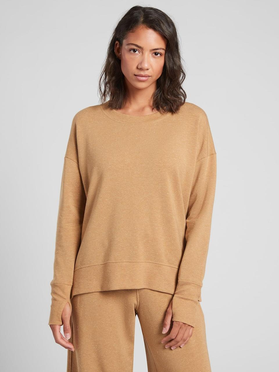 <p>If they're a minimalist, then get them this <span>Athleta Balance Pullover</span> ($79).</p>