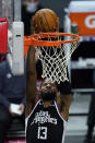 Los Angeles Clippers guard Paul George dunks during the first quarter of the team's NBA basketball game against the Oklahoma City Thunder on Friday, Jan. 22, 2021, in Los Angeles. (AP Photo/Ashley Landis)