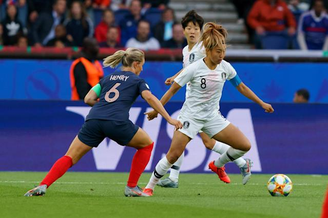 Amandine Henry of France and So-Hyun Cho of Korea battle for the ball during the 2019 FIFA Women's World Cup France group A match between France and Korea Republic at Parc des Princes on June 7, 2019 in Paris, France. (Photo by TF-Images/Getty Images)