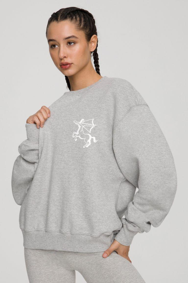 """<p><strong>Good American</strong></p><p>goodamerican.com</p><p><strong>$62.30</strong></p><p><a href=""""https://go.redirectingat.com?id=74968X1596630&url=https%3A%2F%2Fwww.goodamerican.com%2Fproducts%2Fzodiac-boyfriend-sweatshirt-sagittarius&sref=https%3A%2F%2Fwww.seventeen.com%2Ffashion%2Fg34670591%2Fzodiac-gifts%2F"""" rel=""""nofollow noopener"""" target=""""_blank"""" data-ylk=""""slk:Shop Now"""" class=""""link rapid-noclick-resp"""">Shop Now</a></p><p>Let's be honest, you're not wearing real clothes again any time in the foreseeable future.</p>"""