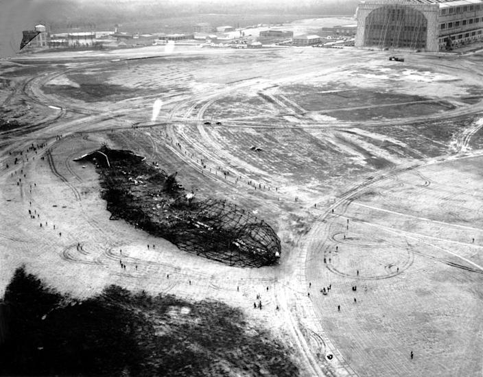 <p>An aerial view taken on May 7, 1937 of the remnants of the airship Hindenburg after exploding in Lakehurst, New Jersey on May 6, 1937. (AP) </p>