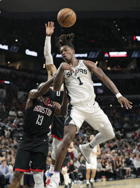 San Antonio Spurs guard Lonnie Walker IV (1) is fouled by Houston Rockets guard James Harden (13) during the second half of an NBA basketball game in San Antonio, Tuesday, Dec. 3, 2019. San Antonio won 135-133 in double overtime. (AP Photo/Eric Gay)