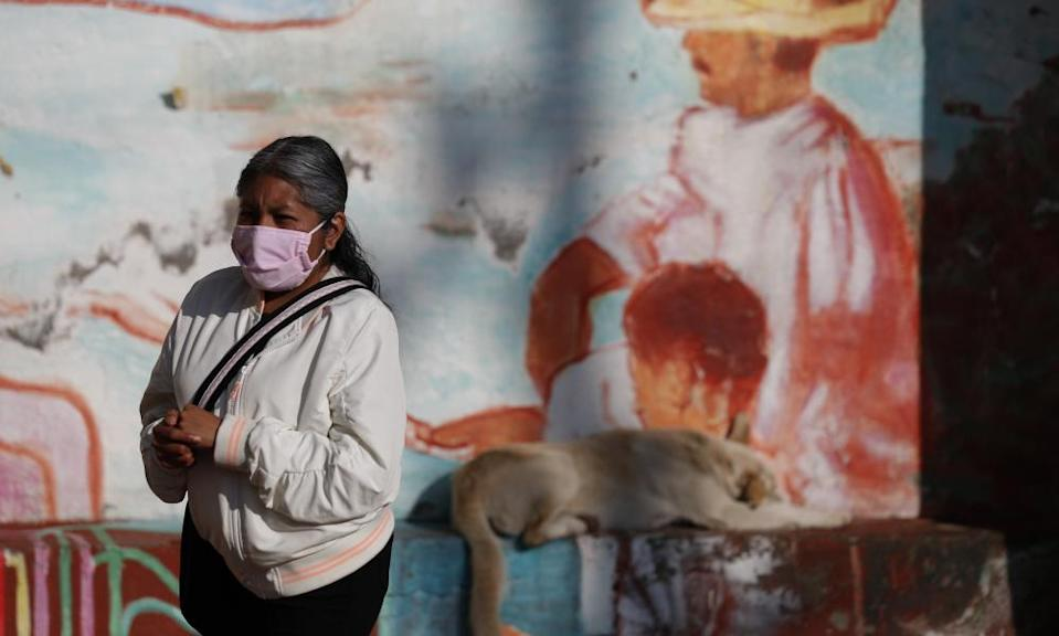 "<span class=""element-image__caption"">A woman rubs antibacterial gel into her hands as she waits in a distanced line to get tested for Covid-19 at a mobile diagnostic tent in San Gregorio Atlapulco in the Xochimilco district of Mexico City on Wednesday.</span> <span class=""element-image__credit"">Photograph: Rebecca Blackwell/AP</span>"
