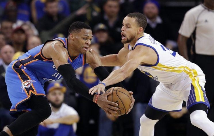Stephen Curry and Russell Westbrook fought for one starting spot in the Western Conference. (AP)