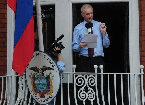 Wikileaks founder Julian Assange addresses the media from the balcony of the Ecuadorian Embassy in London