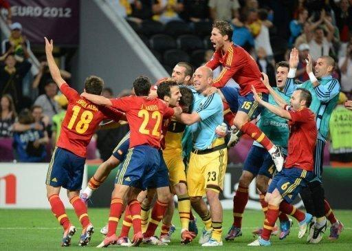 Spain's players celebrate at the end of their penalty shootout victory over Portugal