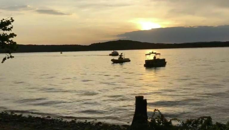 Crews working at the scene where a tourist boat capsized and sank during an intense storm near Branson, Missouri