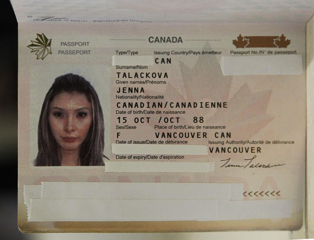"Jenna Talackova, who advanced to the finals of the Miss Canada competition, part of the Miss Universe contest, andwas recently forced out of the competition, is listed in her passport as female, with other personal identifying information redacted by the source before the photo was made, seen at a news conference in Los Angeles Tuesday, April 3, 2012. Talackova says she was forced out of the competition because Pageant officials alleged she was not ""a naturally-born female."" (AP Photo/Reed Saxon)"