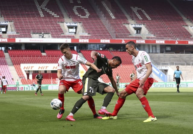 The Bundesliga restarted on May 16 behind closed doors and with strict safety protocols (Lars Baron/AP)