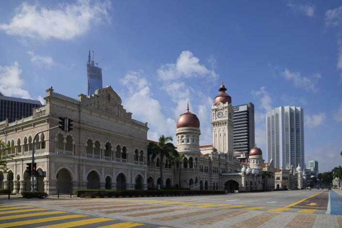 The roadway in front of the Dataran Merdeka, known as Independence Square, is empty during the first day of Full Movement Control Order (MCO) in Kuala Lumpur, Malaysia, Tuesday, June 1, 2021. Malls and most businesses in Malaysia shuttered Tuesday as the country began its second near total coronavirus lockdown to tackle a worsening pandemic that has put its healthcare system on the verge of collapse. (AP Photo/Vincent Thian)