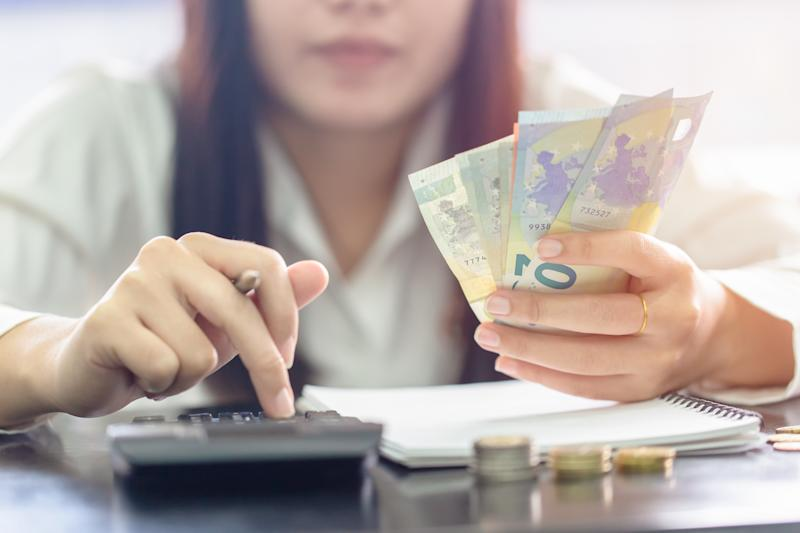Woman counting money Euro banknotes, Business or stock market concept image.