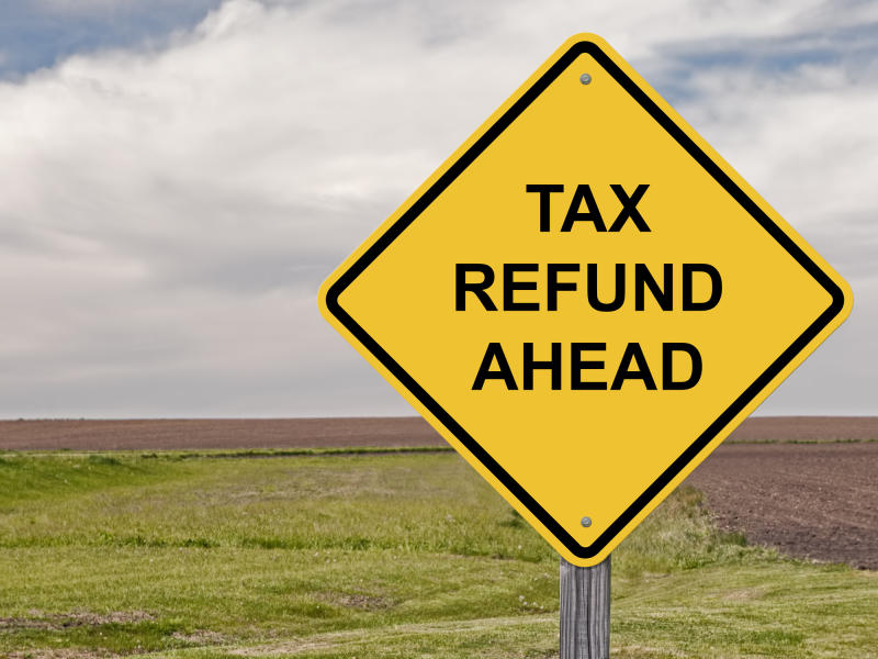 Road sign saying tax refund ahead