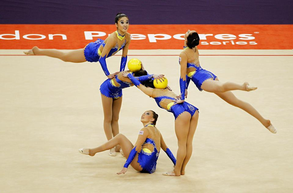 The Great Britain team in action in the Group All-Around event during the FIG Rhythmic Gymnastics Olympic Qualification round at North Greenwich Arena in London.
