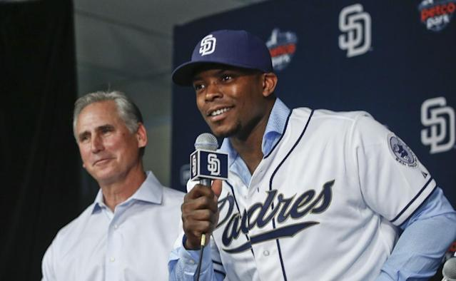 Recently acquired outfielder Justin Upton of the San Diego Padres is flanked by manager Bud Black at a news conference where the Padres introduced four of their new players Tuesday, Jan. 6, 2015, in San Diego. (AP Photo/Lenny Ignelzi)