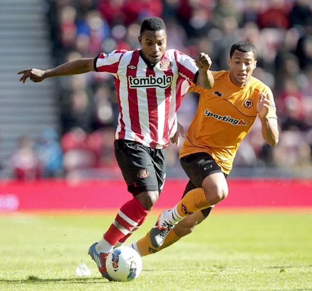 "Sunderland's Beninese midfielder Stephane Sessegnon (L) vies with Wolverhampton Wanderers' English midfielder David Davis (R) during the English Premier League football match between Sunderland and Wolverhampton Wanderers at The Stadium of Light in Sunderland, north-east England on April 14, 2012. RESTRICTED TO EDITORIAL USE. No use with unauthorized audio, video, data, fixture lists, club/league logos or ""live"" services. Online in-match use limited to 45 images, no video emulation. No use in betting, games or single club/league/player publications. (Photo by Graham Stuart/AFP/Getty Images)"
