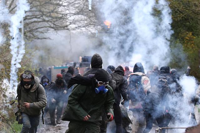 <p>Tear gas floats in the air as protesters retreat and French gendarmes advance with an armoured vehicle during an evacuation operation in the zoned ZAD (Deferred Development Zone) in Notre-Dame-des-Landes, near Nantes, France, April 10, 2018. (Photo: Stephane Mahe/Reuters) </p>
