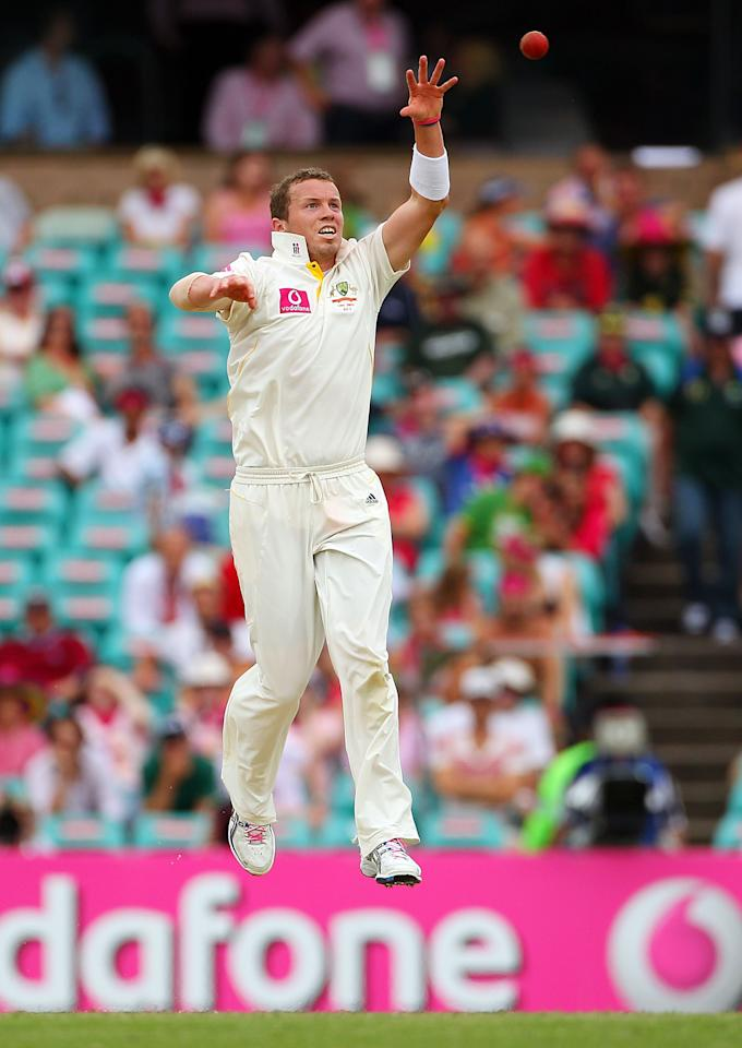 SYDNEY, AUSTRALIA - JANUARY 05:  Peter Siddle of Australia  fields off his own bowling during day three of the Fifth Ashes Test match between Australia and England at Sydney Cricket Ground on January 5, 2011 in Sydney, Australia.  (Photo by Cameron Spencer/Getty Images)