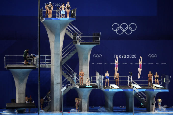 FILE - In this July 21, 2021 file photo, athletes practice during a diving training session at the Tokyo Aquatics Centre at the 2020 Summer Olympics, in Tokyo, Japan. The Tokyo Aquatics Centre is a site to behold -- a towering, 15,000-seat venue that will host swimming and diving at the pandemic-delayed Summer Games. (AP Photo/Matthias Schrader,File)