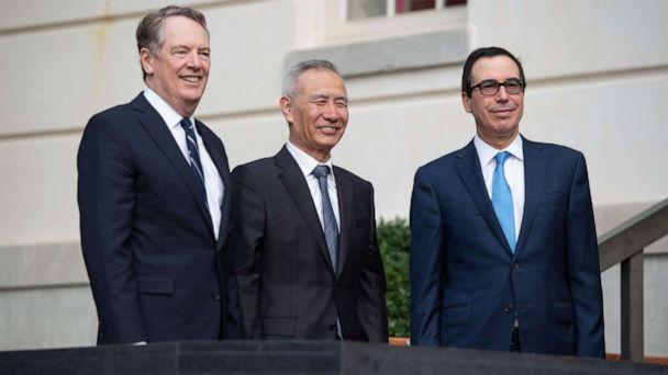PHOTO: Treasury Secretary Steven Mnuchin (R) and Trade Representative Robert Lighthizer (L) greet Chinese Vice Premier Liu He as he arrives for trade talks at the Office of the U.S. Trade Representative in Washington, D.C., Oct. 10, 2019. (Saul Loeb/AFP via Getty Images)