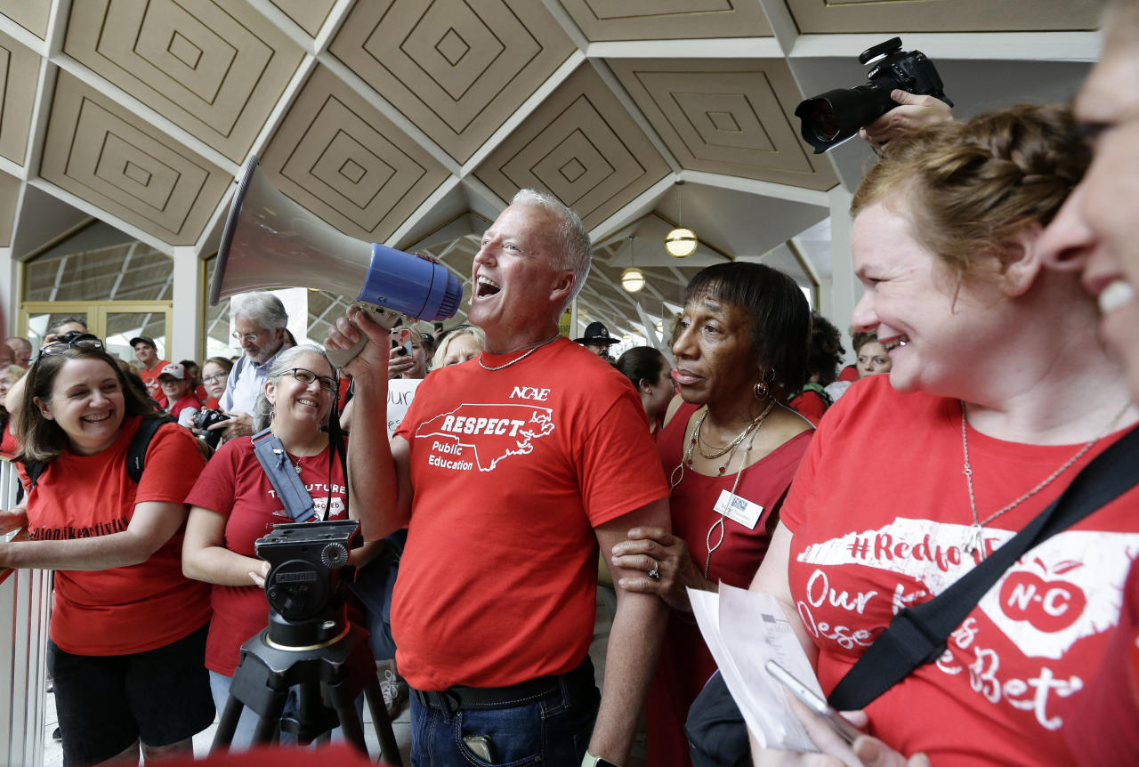 <p>Mark Jewell, president of the North Carolina Association of Educators asks teachers to refrain from chanting and causing a disturbance outside the House and Senate chambers during a teachers rally at the General Assembly in Raleigh, N.C., Wednesday, May 16, 2018. (Photo: Gerry Broome/AP) </p>
