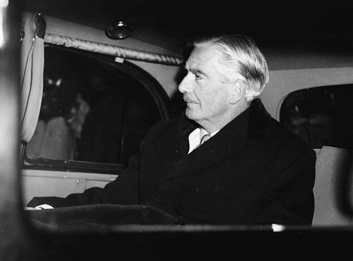 British Prime Minister Sir Anthony Eden in the back of a car, leaving his office at 10 Downing Street for Buckingham Palace, London, January 9th 1957. | John Franks—Keystone/Getty Images