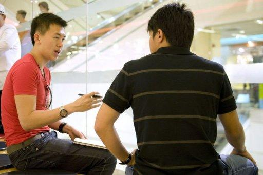 Dating coach Xavier See (left) teaches a student how to speak to women in the hope of finding a girlfriend in Singapore. With 43 percent of Singaporean men between 30 and 34 -- the prime marrying age -- unattached, See has plenty of potential clients in the wealthy city