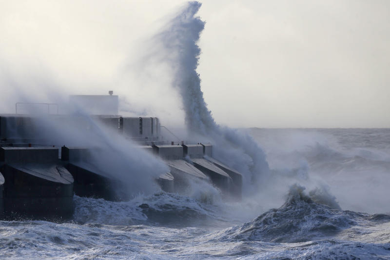 Waves batter into the sea wall of a marina in Brighton, south England, Monday, Oct. 28, 2013. A major storm with hurricane force winds is lashing much of Britain, causing flooding and travel delays with the cancellation of many flights and trains. Weather forecasters say it is one of the worst storms to hit Britain in years. (AP Photo/Sang Tan)