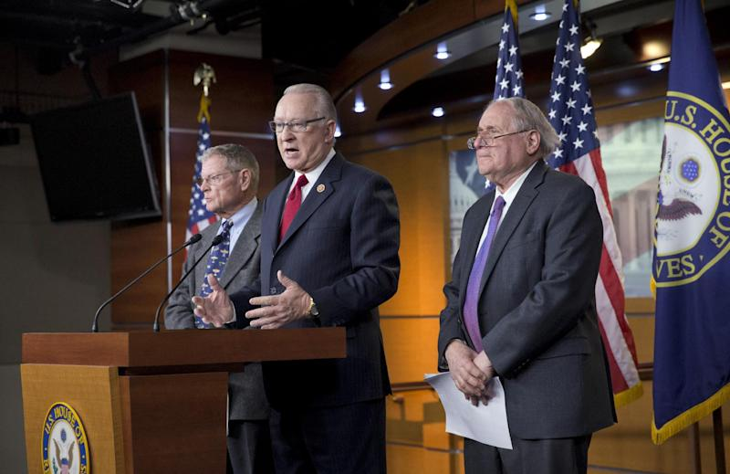 """House Armed Services Committee Chairman Howard P. """"Buck"""" McKeon, R-Calif., center, joined at right by Senate Armed Services Committee Chairman Carl Levin, D-Mich., right, with Sen. James Inhofe, R-Okla., left, the ranking member of the panel, tells reporters they have reached an agreement on funding the Pentagon budget, at a news conference on the Defense Authorization Bill, at the Capitol in Washington, Monday, Dec. 9, 2013. (AP Photo/J. Scott Applewhite)"""