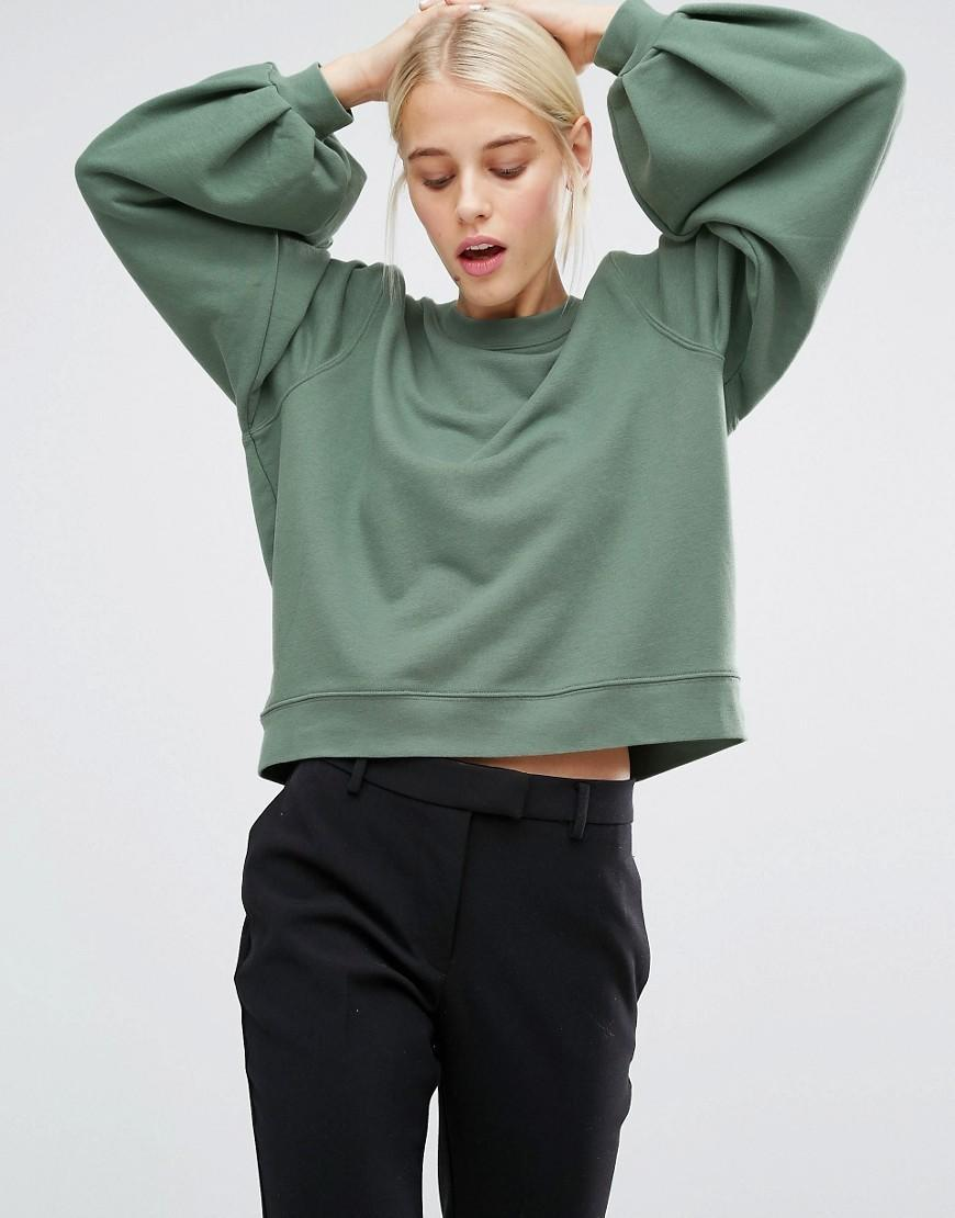 """<p><a href=""""http://www.asos.com/monki/monki-sweater/prod/pgeproduct.aspx?iid=7099622&clr=Khaki&SearchQuery=green&pgesize=204&pge=0&totalstyles=2255&gridsize=3&gridrow=11&gridcolumn=2"""" rel=""""nofollow noopener"""" target=""""_blank"""" data-ylk=""""slk:£25.00 from MONKI"""" class=""""link rapid-noclick-resp"""">£25.00 from MONKI</a></p>"""