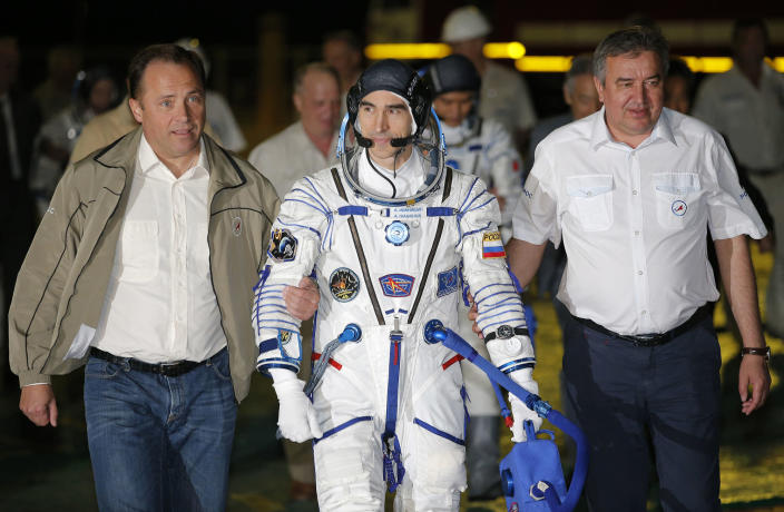 <p>Russian cosmonaut Anatoly Ivanishin, member of the main crew of the mission to the International Space Station (ISS), walks to the rocket prior the launch at the Russian leased Baikonur cosmodrome, Kazakhstan, Thursday, July 7, 2016. (AP Photo/Dmitri Lovetsky, Pool) </p>