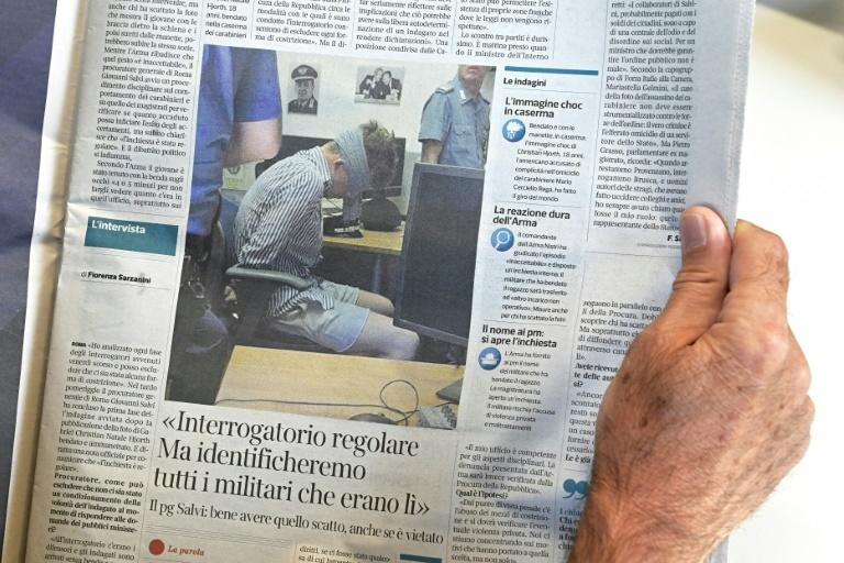 A photograph taken of one of the suspects, Gabriel Natale-Hjorth, blindfolded during interrogation, appeared in media reports, causing outrage (AFP Photo/Vincenzo PINTO)
