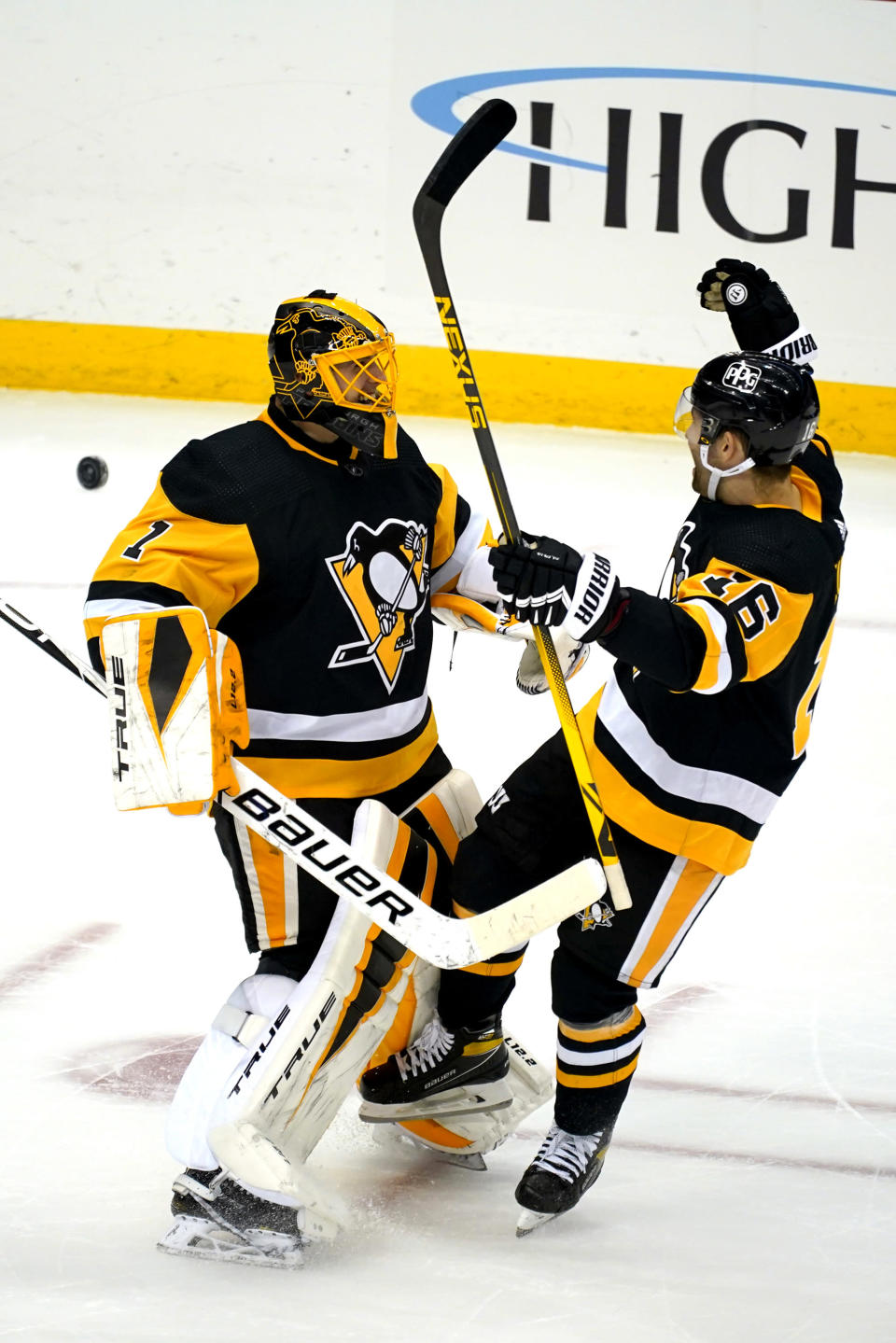 Pittsburgh Penguins goaltender Casey DeSmith (1) celebrates a shootout win over the Washington Capitals with Jason Zucker following an NHL hockey game in Pittsburgh, Sunday, Jan. 17, 2021. (AP Photo/Gene J. Puskar)