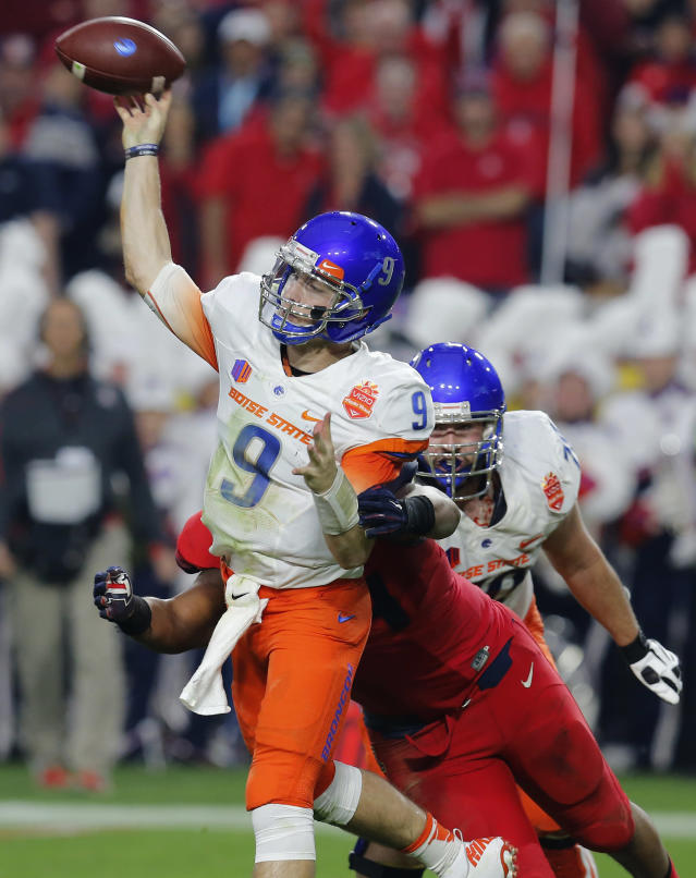 Boise State quarterback Grant Hedrick (9) throws against Arizona during the first half of the Fiesta Bowl NCAA college football game, Wednesday, Dec. 31, 2014, in Glendale, Ariz. (AP Photo/Rick Scuteri)